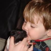 Picture of Ethan with rat
